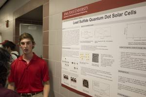 ChE Senior Bryan Cote giving a poster presentation on his research
